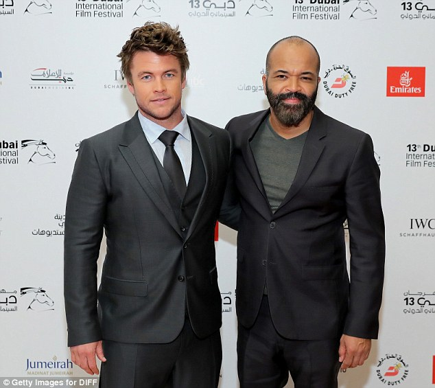 Say cheese: While on the carpet, he (L) posed for photos alongside Jeffrey Wright (R)