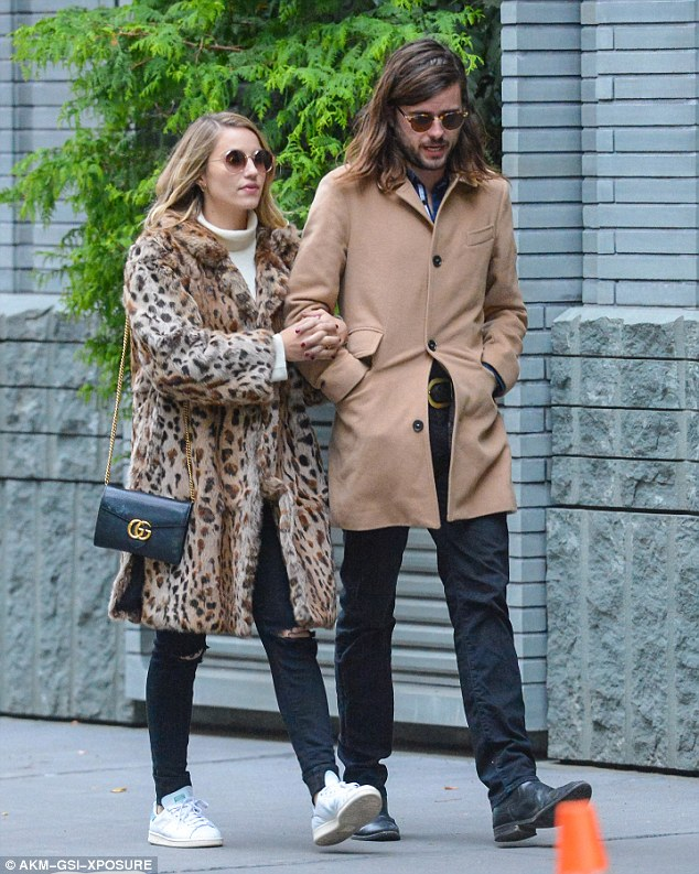 Cute: The Glee star, 30, rocked a chic leopard-print coat as she cosied up to the handsome 28-year-old Mumford & Sons rocker