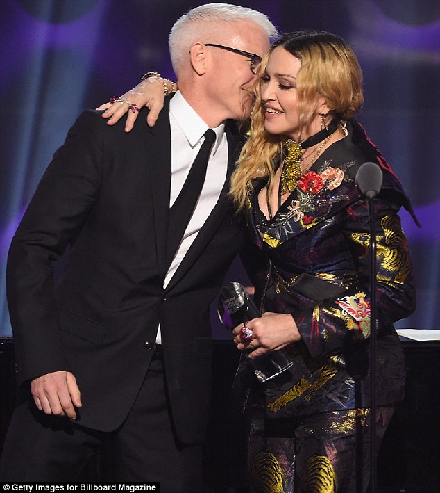 Friends in high places: Madonna was given her gong by macho newsman Anderson Cooper