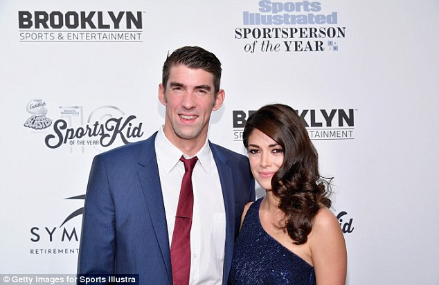 James said that there were 'so many unbelievable achievements of 2016' including those of 23-time Olympic gold medalist, Michael Phelps (pictured with his fiancee Nicole Johnson), who he joking called a 'fish'