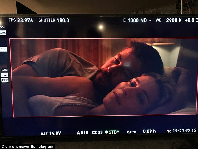 On and off-screen lovers: Chris cuddles up to wife Elsa Pataky on the set of Horse Soldiers