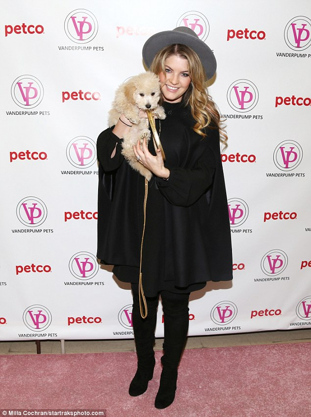Latest addition: Pandora meanwhile brought someone pretty special to the event - her new puppy, Darling