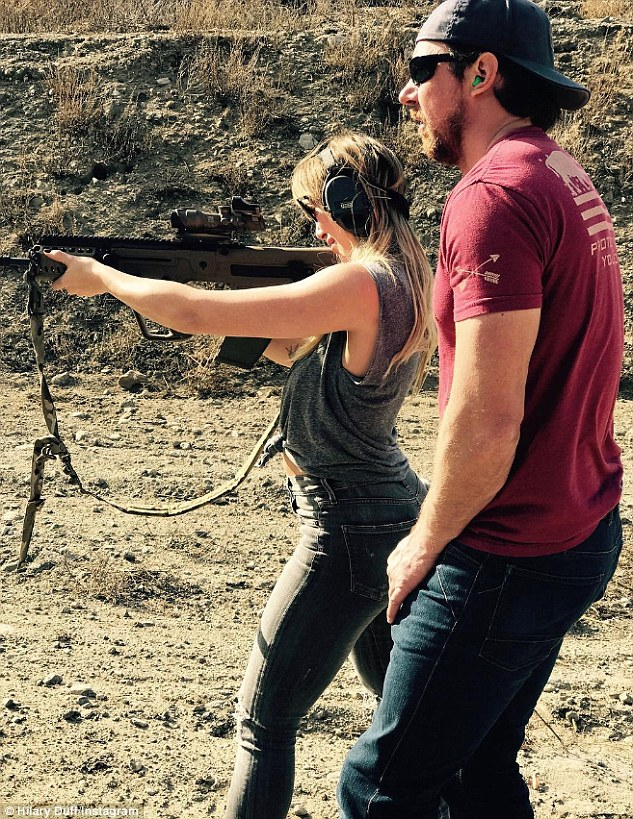 Ready, aim, fire: Hilary posed shots of her shooting session to Instagram on Sunday. Here, the 29-year-old is seen aiming a high-powered rifle