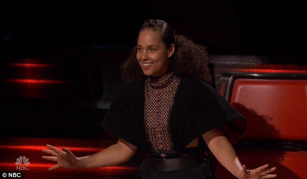So proud: Alicia could not hide her pride and smiled asWé performed