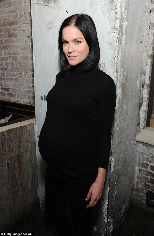 Bump in the night! Pregnant Leigh Lezark rocked a chic black turtleneck frock that clung to her bump