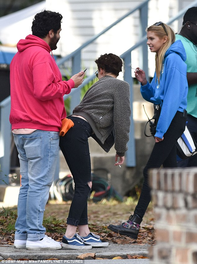 Bright eyed and bushy tailed: K-Stew got her pals laughing with some fun antics on set