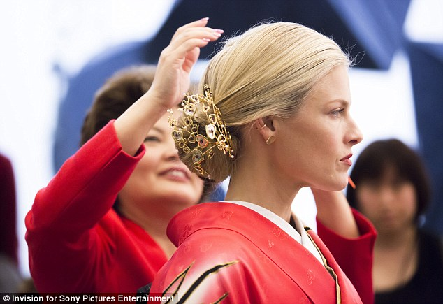 Glam: Her blonde tresses were expertly styled into an elegant updo which was adorned with an intricate gold clip