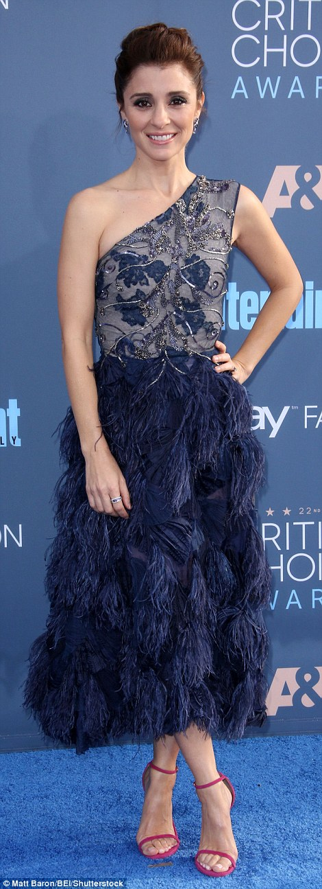 Glam look: Shiri Appleby looked gorgeous in an asymmetric dress with feather skirt
