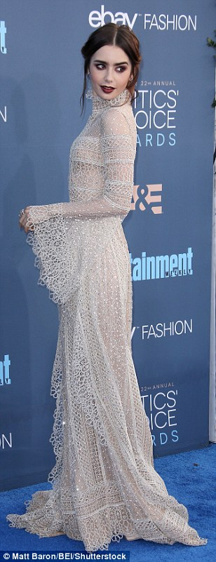 Getting it right: Lily Collins stunned in a delicate high-neck dress with gothic hair and makeup