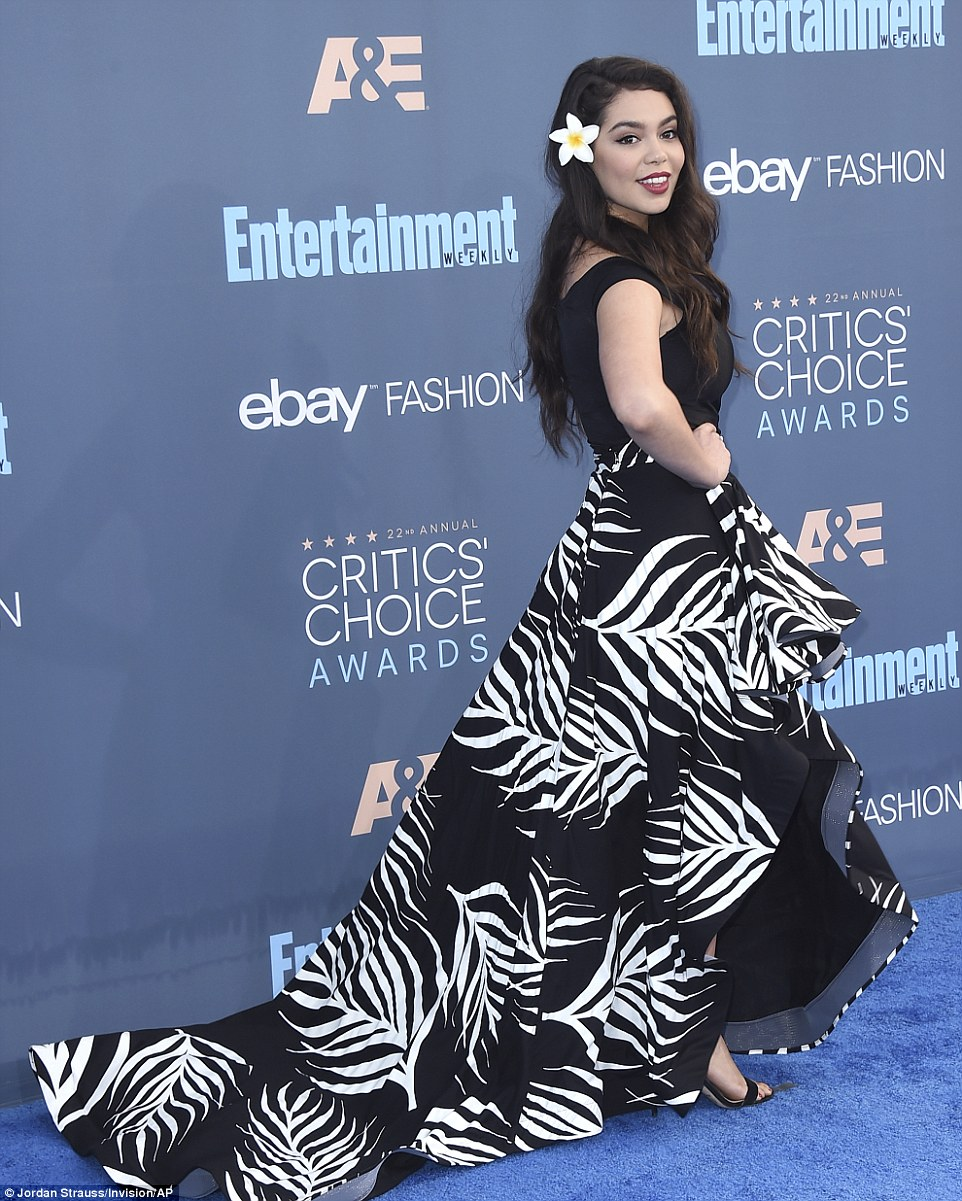Tropical temptress: Actress Auli'i Cravalho also wore a bold leaf print as she made her entrance