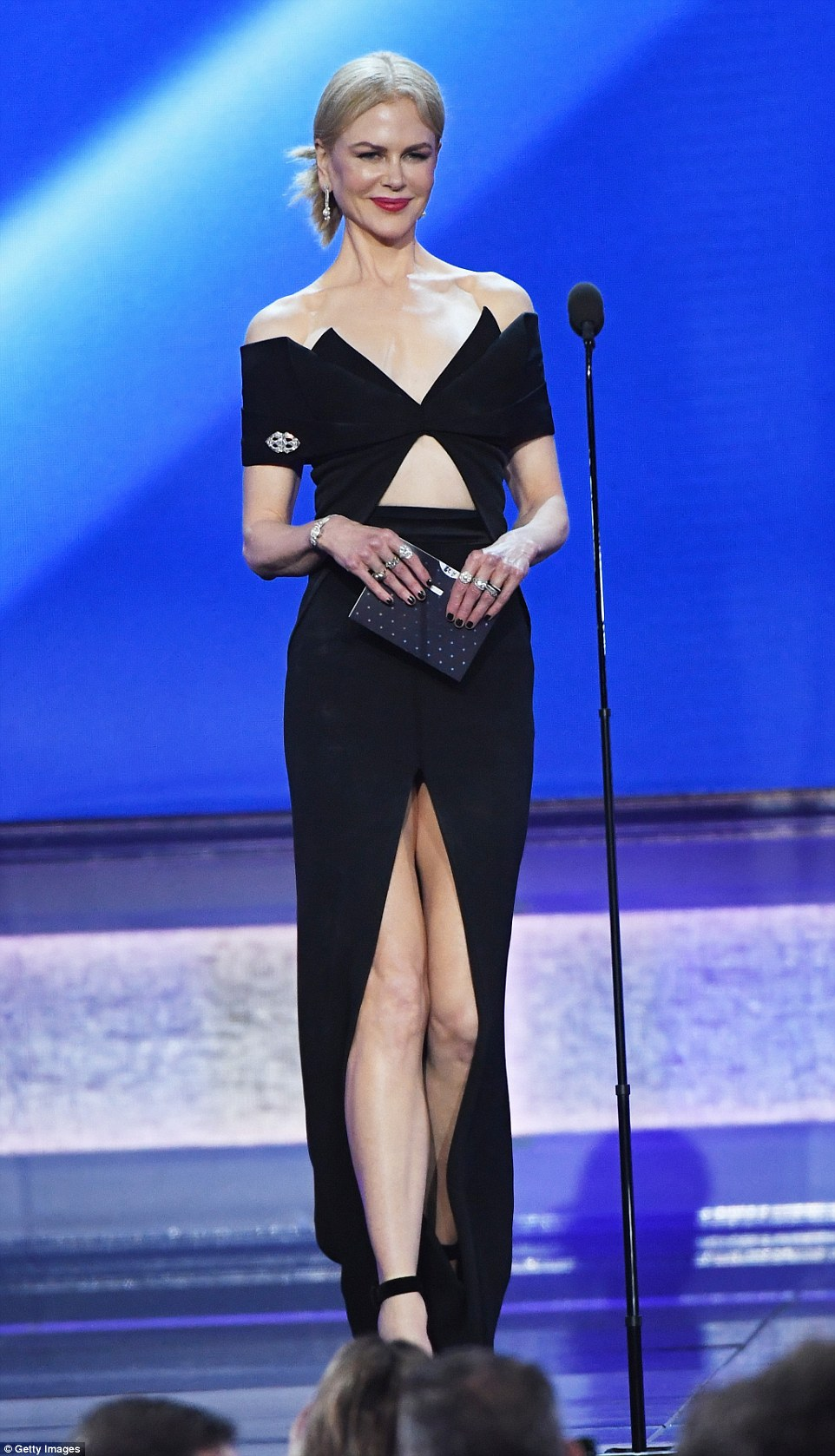Back in black: Nicole Kidman put on a leggy display as she presented the Best Actor gong