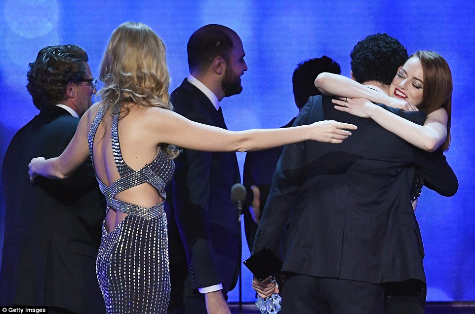 Proud: Emma gave the director a big hug at the end of his speech