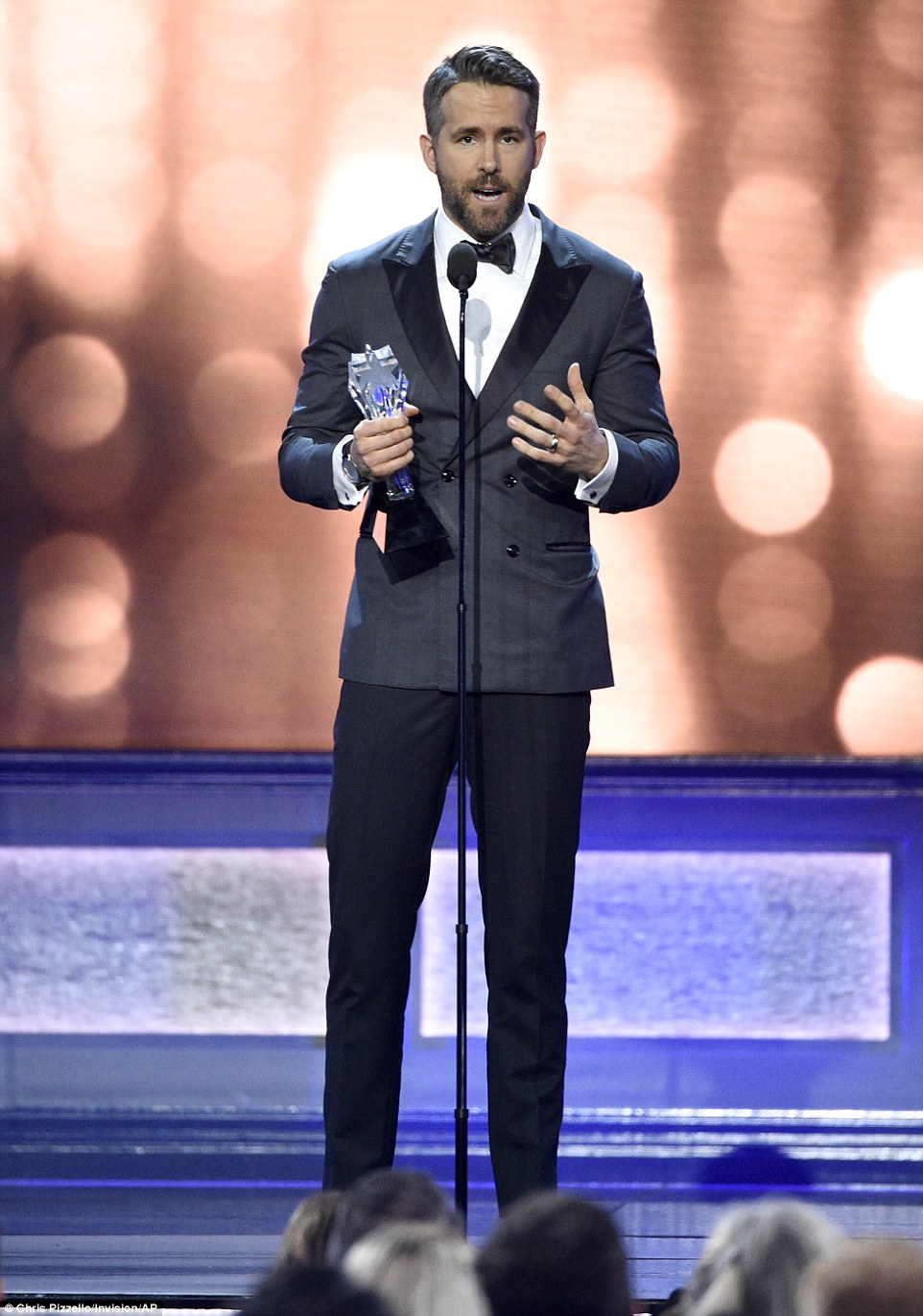 Handsome: Ryan Reynolds accepted the Entertainer of the Year award presented by Entertainment Weekly