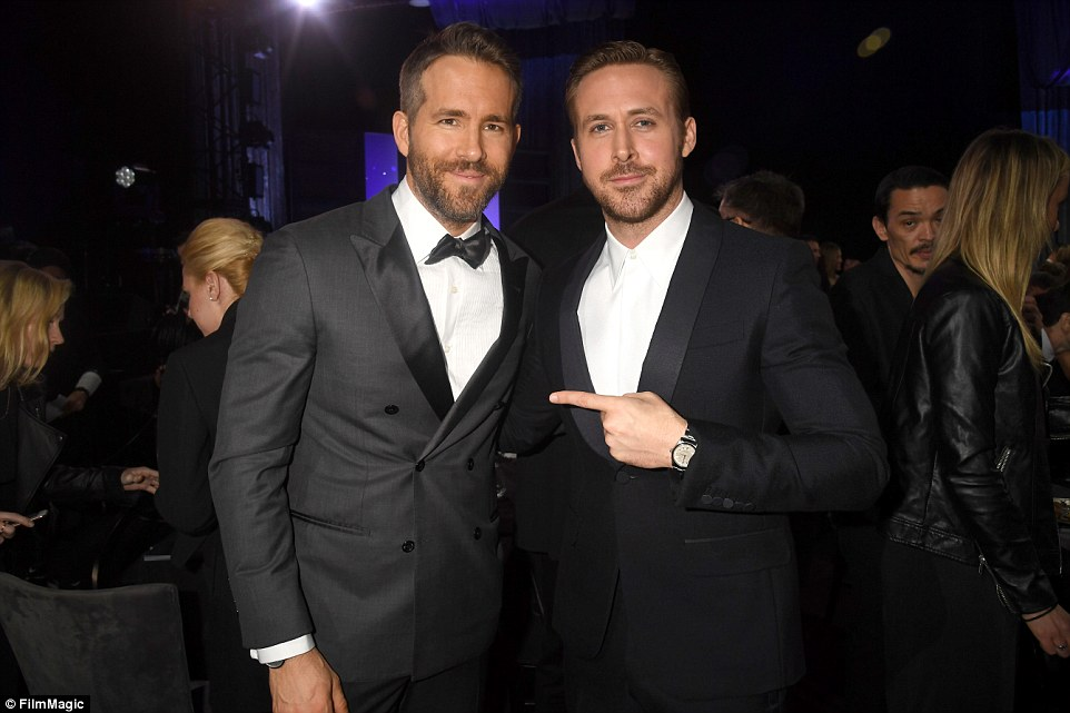 Handsome contest: Ryan Reynolds and Ryan Gosling posed for a picture backstage