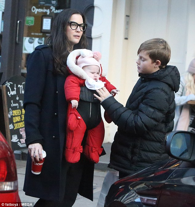 Yummy mummy! Liv Tyler, 39, carried her five-month-old daughter Lula Rose around in an adorable red babygro during a shopping trip in London on Sunday