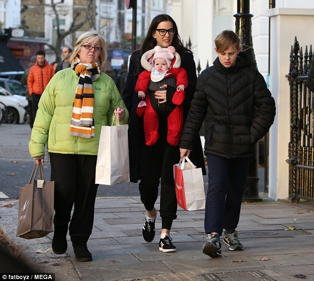 Family affair: The actress, who looked casual in trainers and leggings, was also joined by her 11-year-old son Milo for the winter stroll in the upmarket neighbourhood