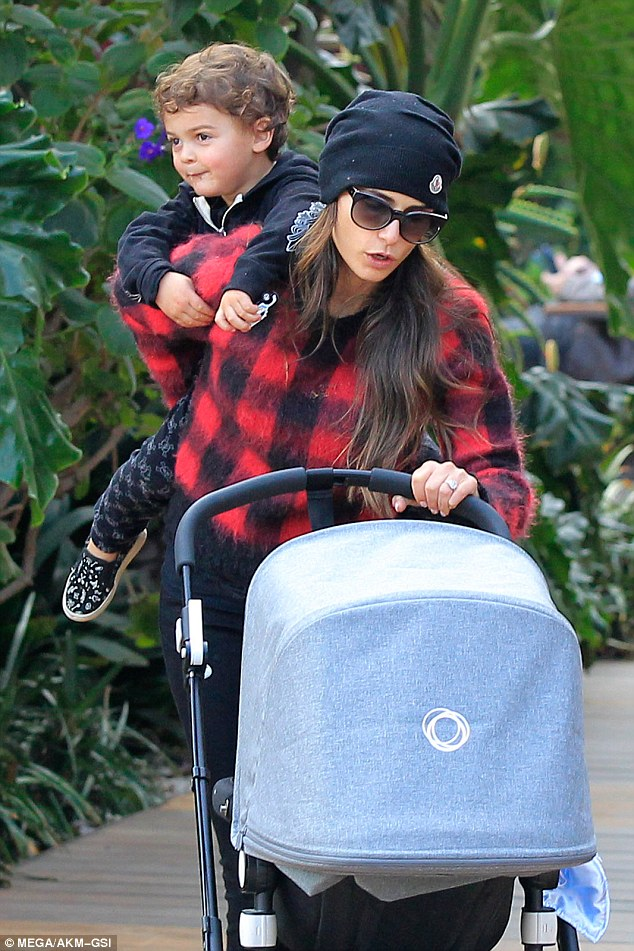Juggling act: Jordana Brewster definitely had her hands full as she pushed new baby Ryan in a stroller while carrying three-year-old son Julianon her back on Sunday in LA