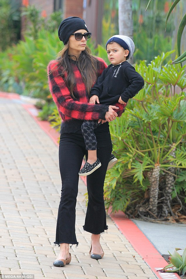 Jordana welcomed Julian, three, in September 2013. The youngster was nattily dressed in check pants with matching shoes and a dark blue sweater with two-tone knitted hat