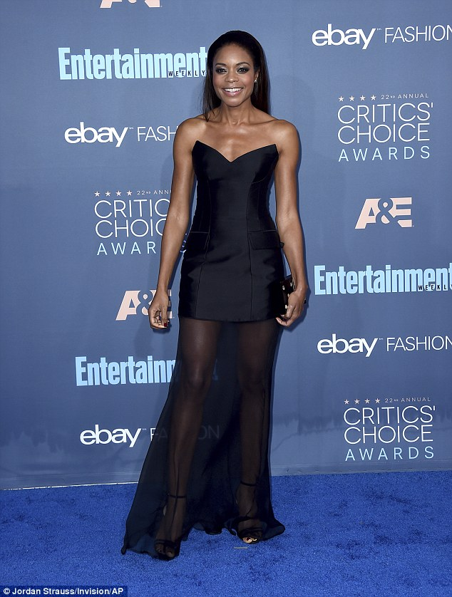 Just gorgeous:Naomie's edgy sleeveless frock had a triangular-cut neckline and a sheer skirt that draped to the floor