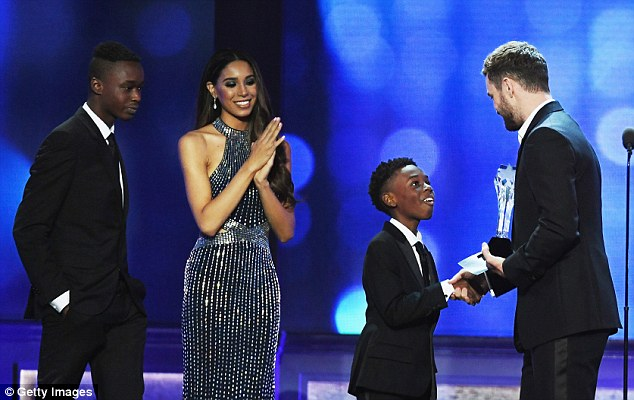 It's an honour: The young star graciously shook Justin Timberlake's hand as he and his co-stars were recognised for their work behind-the-camera