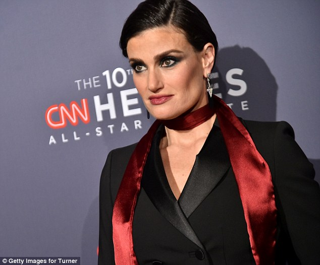 Striking look: The Frozen star wore her raven locks in a severe style with black lidded eyes lined with plenty of kohl and mascara and added dark red lip color
