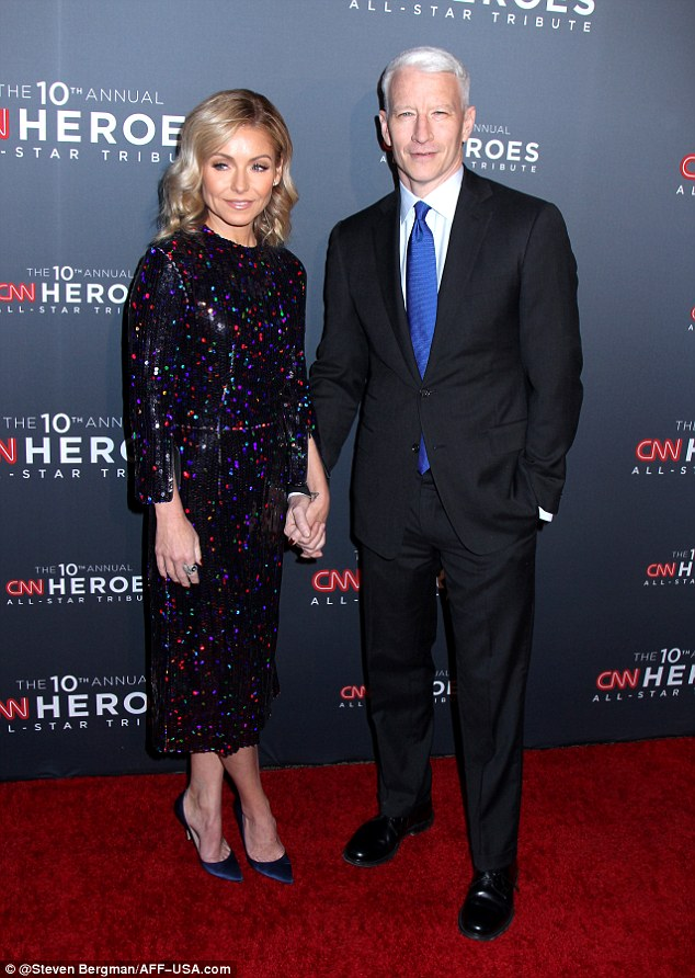 """Pals"""" Co-hosting the event held at New York's American Museum of Natural History were CNN's Anderson Cooper and Live!'s Kelly Ripa, who held hands on the red carpet"""