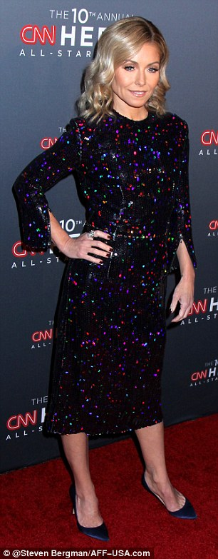 Showy choice: Ripa was dressed in a below-the-knee dress that was covered in colorful shiny dots