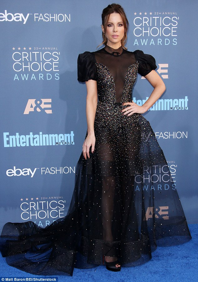 Mesh-merising!The Underworld star looked truly mesmerising in the floor-length gown, which was formed entirely of black mesh to reveal her long legs and killer figure