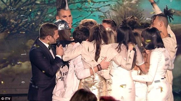 Group hug! Host Dermot O'Leary, left, looked on as the contestants swarmed Matt