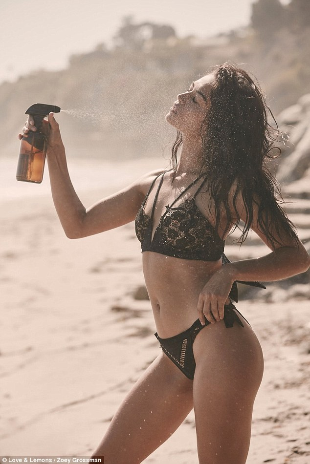 Wet, wet, wet: Ensuring she kept the beach theme of the look, Shanina wore her tresses in wet beachy waves which she moistened with a spritz later in the shoot