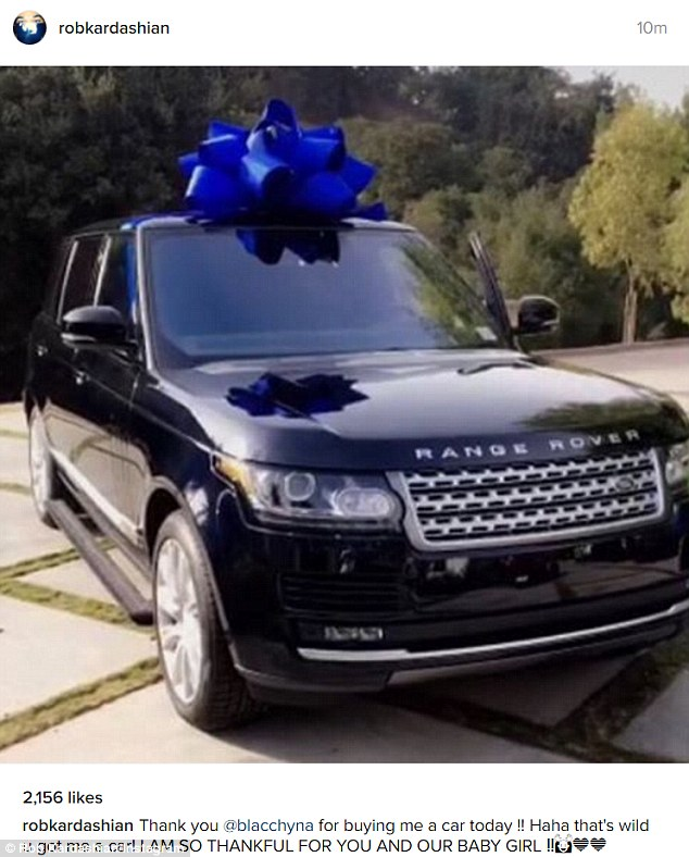 Generous: The day before, the then-dark-haired Chyna gifted Rob with a midnight blue new Range Rover