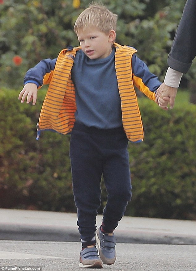 Casual: Samuel was cute in a blue shirt and jeans with an orange and blue jacket