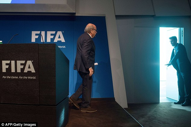 Blatter heads for the exit door at FIFA's headquarters in Zurich after announcing his resignation on Tuesday