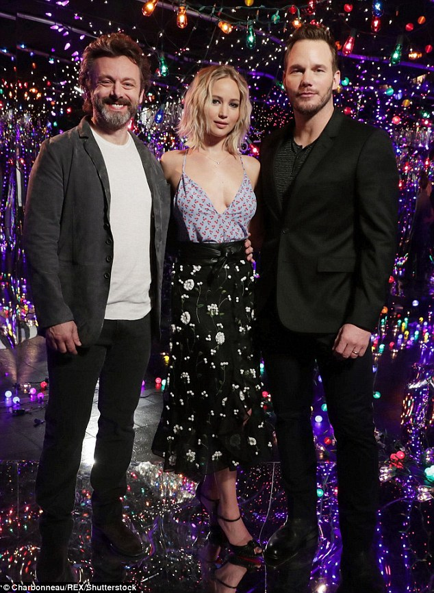 Astronomical: Lawrence and Pratt posed with co-star Michael Sheen, who kept things casual in a white T-shirt, jeans, and jacket