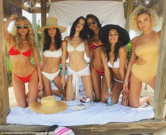 Fun: She wore a white bikini with a straw hat for a photo session with Bella, Elsa, Lais Ribeiro, Rose Bertram and Gizele Oliveira; (from l to r) Elsa, Emily, Bella, Lais, Gizele and Rose