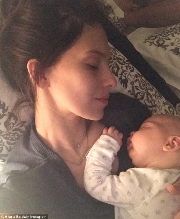 Sleepy selfie: The mother-of-three also shared her own sleeping selfie with the family's newest addition on Friday
