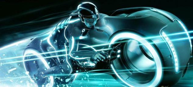 A still from the new Tron: Legacy film which shows computer programmes and humans racing on Lightcycles