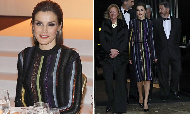 Queen Letizia arrives for Madrid awards ceremony wearing a sparkly striped dress