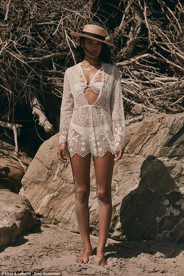 Wrapped up:Covering up more later in the shoot, Shanina wore a chic lace cover-up - which was yet another of Love And Lemons key designs - complete with lavish appliques and delicate material