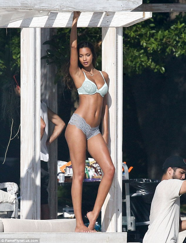 Radiant! Brazilian beauty Lais made sure to turn heads as her endless lean limbs and sculpted abs glistened in the sun