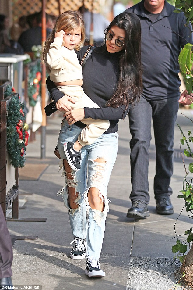 Hands-on mom! Kourtney Kardashian carried her daughter Penelope for a lunch date with Scott Disick at Il Pastaio in Beverly Hills on Tuesday
