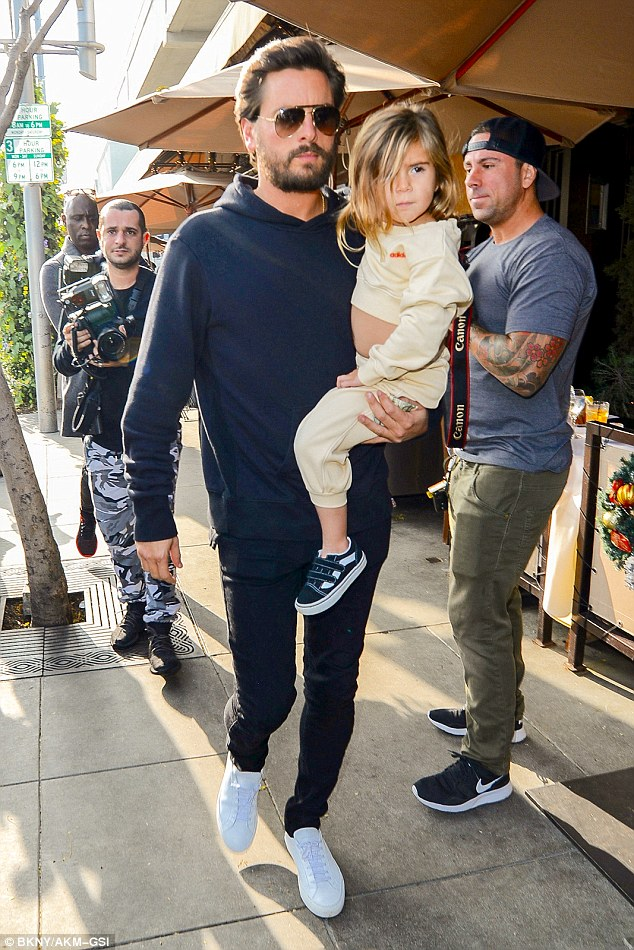 Daddy's little girl: Doting dad Disick took turns carrying Penelope