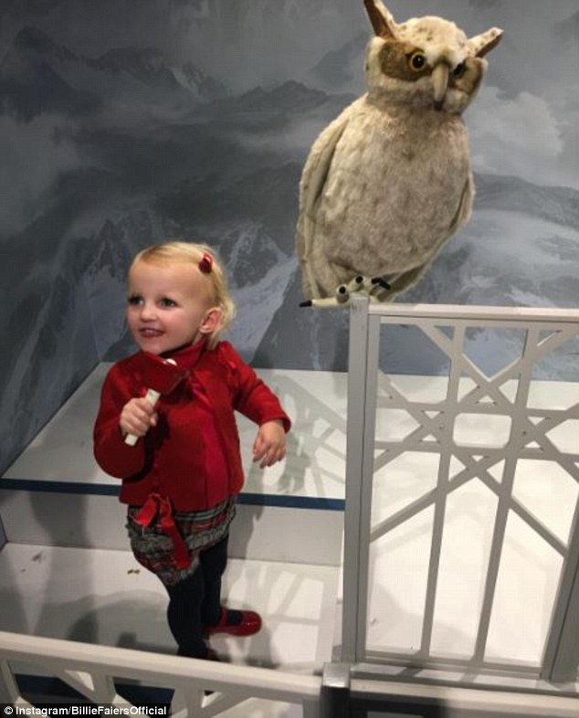 Cute: Billie Faiers came under fire on Tuesday as she shared an adorable snap of two-year-old Nelly at Santa's Grotto, which some fans believed showed her wearing make-up