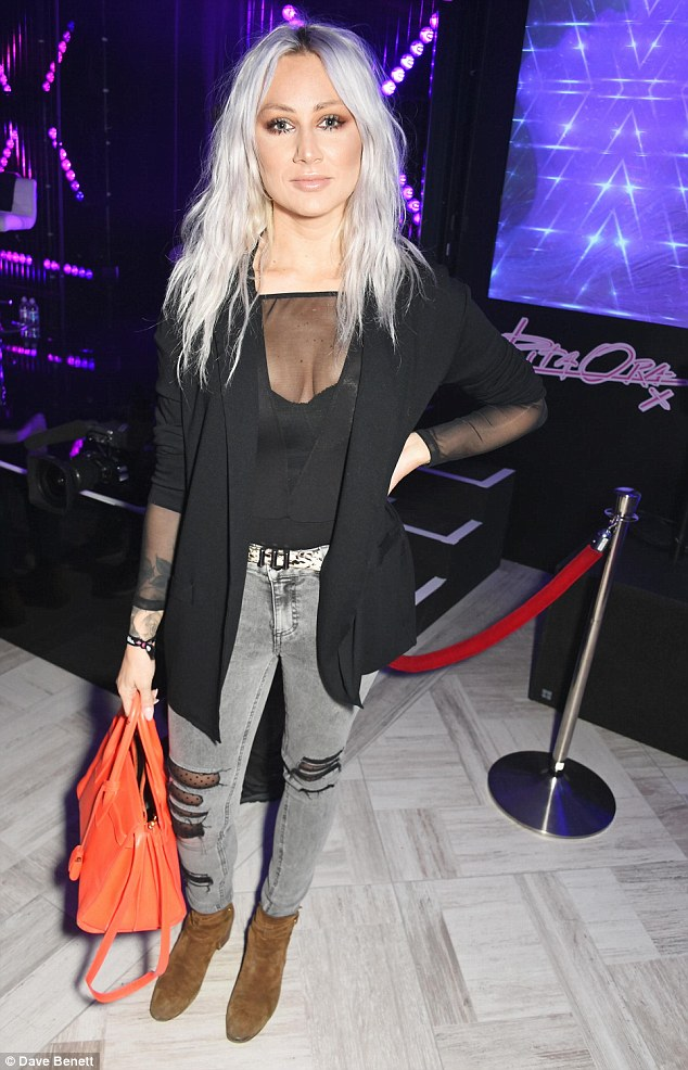 Busty babe: One Direction make-up artist Lou Teasdale looked sensational in a sheer top tucked into a pair of skin-tight grey jeans