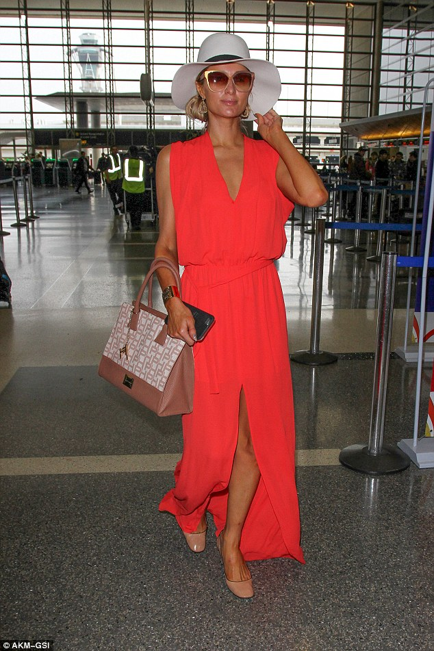 Boarding! The Simple Life star told Harper's 'I want to be known as a businesswoman'. Here, she looks red hot while catching a flight from LAX