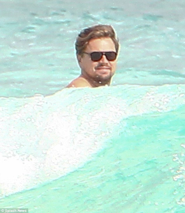 Give us a wave: The actor seemed in high spirits as he larked around in the water