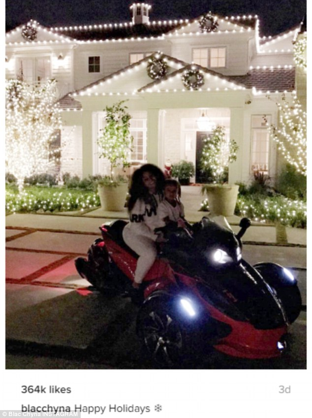 Bright lights: Chyna shared an Instagram snap on Saturday of herself and son King Cairo, four, in front of Kylie's house lit up for the holidays