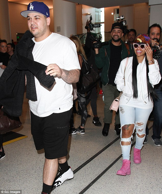 Whirlwind romance: Rob and Chyna, shown in March in Los Angeles, started dating in January