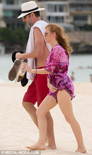 Quick adjustment: The 40-year-old actress donned a tie-dye fuchsia kaftan, featuring an embellished border around the thigh-skimming beach cover all, which she was seen adjusting as they left the beach