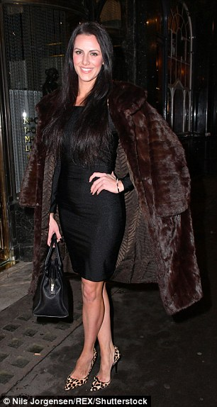 Furry nice! Jessica dazzled in a figure-hugging black dress, whilst she layered up with a brown opulent coat with brown fur pleats and donned leopard print heels